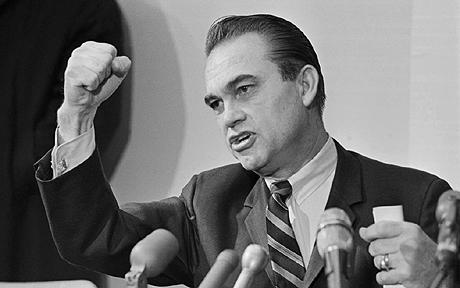 George Wallace on His Campaign Trail...19 Feb 1968, Pittsburgh, Pennsylvania, USA --- 2/19/1968-Pittsburgh, PA- Former Alabama Governor George Wallace, an ex-boxer, punches out with clenched fists emphasizing a point during his visit here. Wallace Kicked off the Pennsylvania phase of his campaign for President on an Independent Party ticket. --- Image by  Bettmann/CORBIS