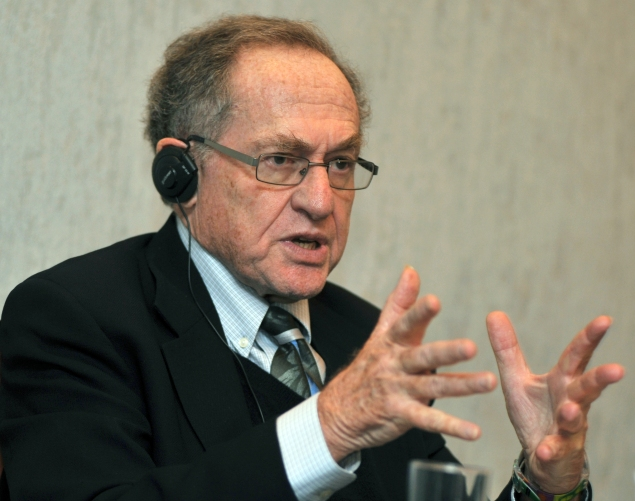 Alan Dershowitz, gestures during his press conference in Kiev on April 11, 2011. Ukraine's ex-president Leonid Kuchma hired Alan Dershowitz, a star US lawyer, who worked on the O.J. Simpson trial to act as an advisor in his defence against charges over the murder of a reporter. AFP PHOTO/GENYA SAVILOV (Photo credit should read GENYA SAVILOV/AFP/Getty Images)