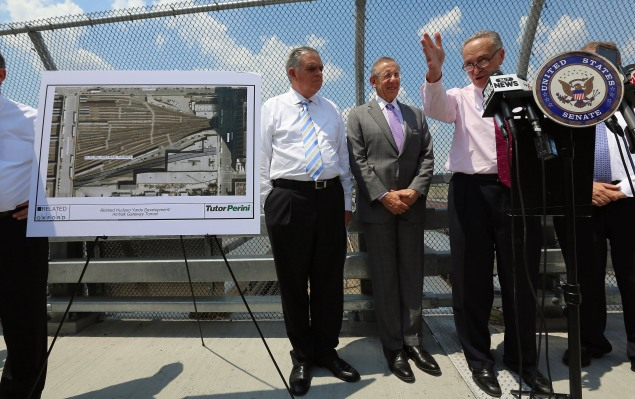 NEW YORK, NY - MAY 30:  (R-L) U.S. Sen. Charles Schumer (D-NY) (R) speaks as Hudson Yards developer Stephen Ross and (C) and U.S. Transportation Secretary Ray LaHood look on at a news conference at the Hudson Yards site in Manhattan on May 30, 2013 in New York City.  LaHood said $185 million in Federal Transit Administration funds will be used to construct an encasement around two proposed train tunnels at the site in order to prevent the type of tunnel flooding that happened during Hurricane Sandy as part of the larger 'Gateway' Amtrak tunnel project.  (Photo by Mario Tama/Getty Images)