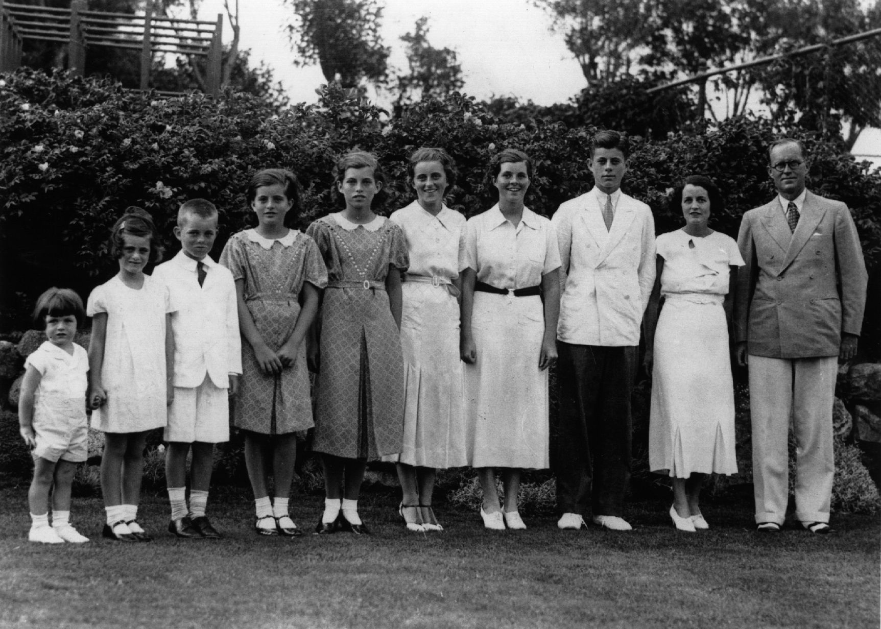 1937: American multi-millionaire Joseph Patrick Kennedy (right), the newly-appointed ambassador to London, with his wife Rose Kennedy (second from right) and eight of their nine children, in London. From left: Edward, Jeanne, Robert, Patricia (1924 - 2006), Eunice, Kathleen, Rosemary and John F Kennedy who later became the 35th President of the United States. (Photo by Keystone/Getty Images)