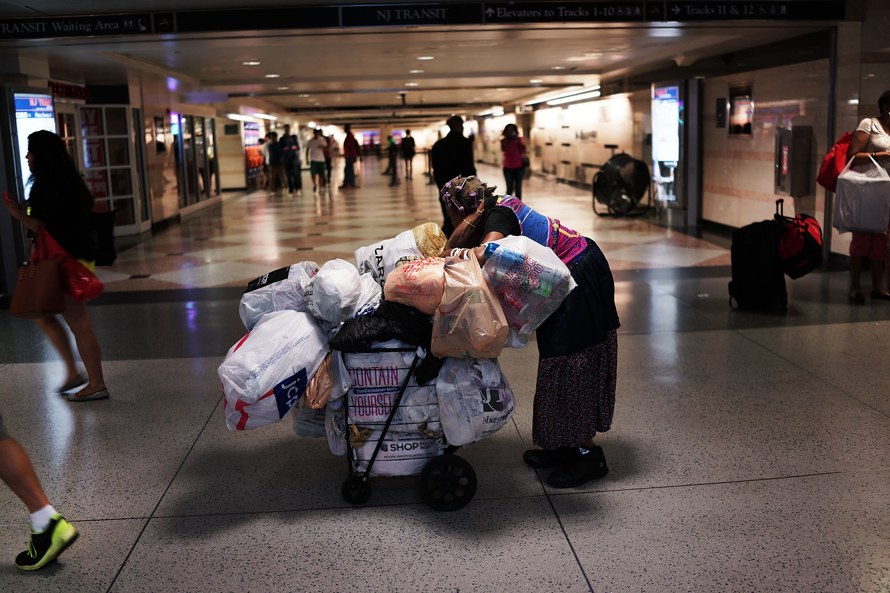 A homeless woman pauses in a Manhattan train station.