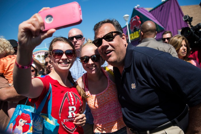 Chris Christie takes a selfie with fans while touring the boardwalk on August 29, 2014 in Point Pleasant, New Jersey. (Andrew Burton/Getty Images)