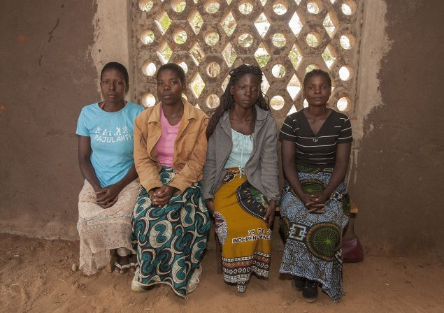 Sitting from left: Yvone Kambiza, 16, Alinafe Naison, 19, Catherine Julio Funsani, 21, and Katrina Kampingo, 15, who were underage brides sit on March 7, 2015 inside a hall at the Gender Equality and Women Empowerment (GEWE), a local organization whose objective is to fight early marriages and teenage pregnancies at the Mponela Trading Center in the area of Traditional Authority Mponela in Dowa District, some 70 kms north of the capital Lilongwe. Kambiza and Naison have since returned to school. Malawi is poised to adopt a law banning child marriages in a country which has one of the world's highest rates of under-age weddings. AFP PHOTO / AMOS GUMULIRA (Photo credit should read AMOS GUMULIRA/AFP/Getty Images)