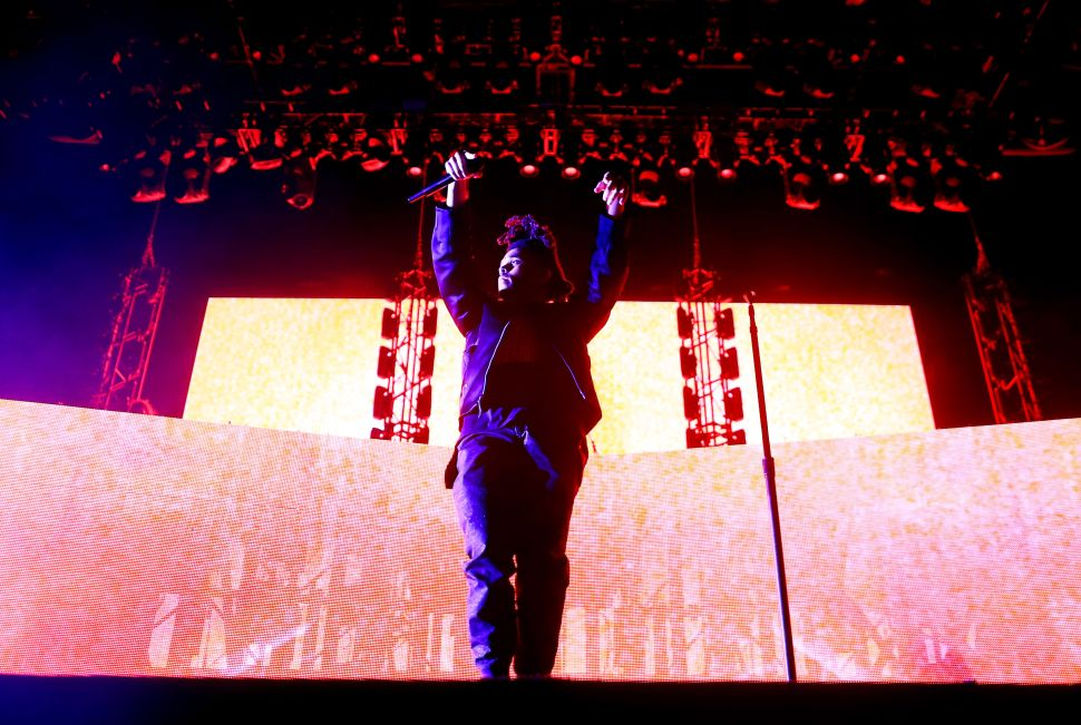 perform onstage during day 2 of the 2015 Coachella Valley Music & Arts Festival (Weekend 1) at the Empire Polo Club on April 11, 2015 in Indio, California.