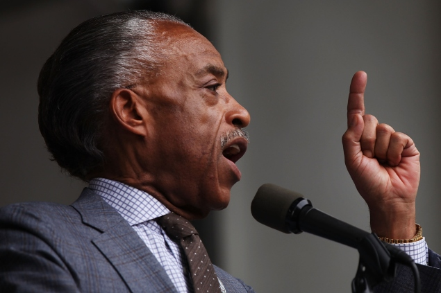 NEW YORK, NY - JULY 18: The Reverend Al Sharpton speaks at a rally in Brooklyn to call for justice for Eric Garner one year after he died in an apparent police chokehold on July 18, 2015 in New York City. The rally of several hundred people was held in front of the U.S. Attorney's Office in Downtown Brooklyn. Members of Garner's family joined Sharpton in demanding a federal investigation into his death. Garner, who was killed in a controversial choke-hold by a Staten Island police officer, had been approached by police for selling loose cigarettes. His death set off waves of protests around the city and country. Garner's family has settled with the city for 5.9 million in a wrongful death suit. (Photo by Spencer Platt/Getty Images)