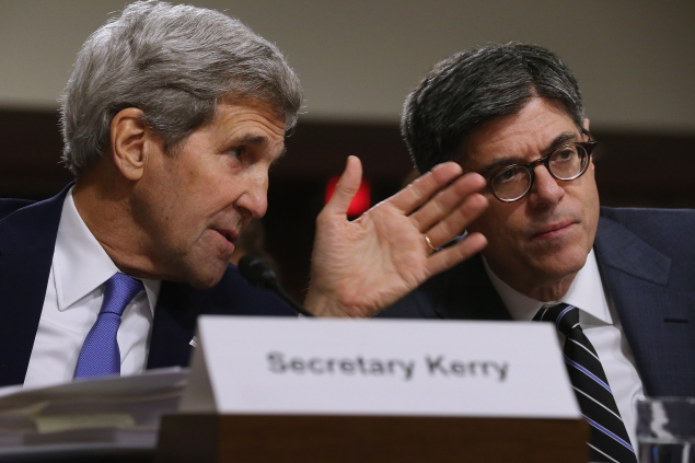 WASHINGTON, DC - JULY 29:  Secretary of State John Kerry (L) talks with Treasury Secretary Jacob Lew as they testify before the Senate Armed Services Committee about the nuclear deal struck between Iran and six nations, including the United States, on Capitol Hill  July 29, 2015 in Washington, DC. Kerry and Energy Secretary Ernest Moniz met with the Iranians in Europe to negotiate the deal, which the Obama administration says will eliminate Iran's ability to make a nuclear weapon for at least ten years.  (Photo by Chip Somodevilla/Getty Images)