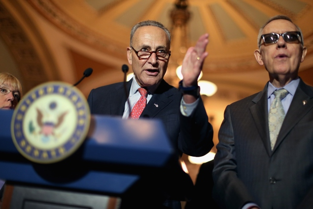 WASHINGTON, DC - AUGUST 04:  Sen. Charles Schumer (D-NY) (L) and Senate Minority Leader Harry Reid (D-NV) talk with reporters after the weekly Democratic policy luncheon at the U.S. Capitol August 4, 2015 in Washington, DC. Reid said there would be enough support to move a cybersecurity bill forward if Democrats were able to offer relevant amendments.  (Photo by Chip Somodevilla/Getty Images)