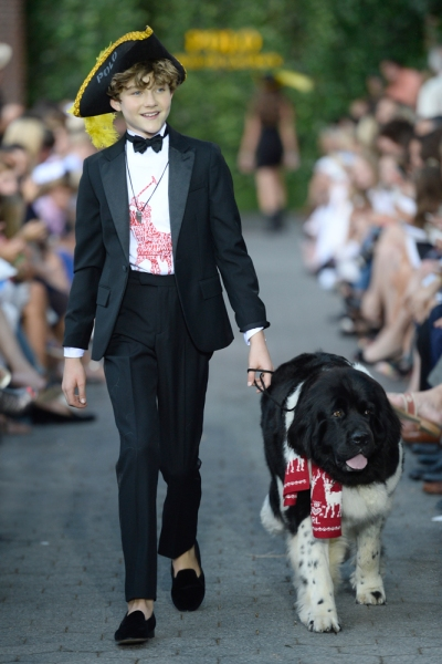 A model and his dog walk at the Fashion Show (Photo: Getty Images)