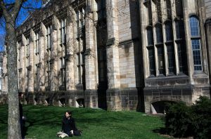 NEW HAVEN, CT - APRIL 15: A woman sits on the grass on the campus of Yale University April 15, 2008 in New Haven, Connecticut. New Haven boasts many educational and cultural offerings that attract visitors to the city. (Photo by Christopher Capozziello/Getty Images)