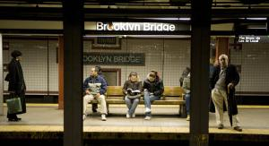 Subway riders wait on the platform. (Photo: DON EMMERT/AFP/Getty Images)