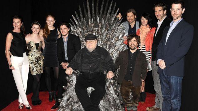 George RR Martin with cast, crew and throne. (Jason LeVaris/Getty)