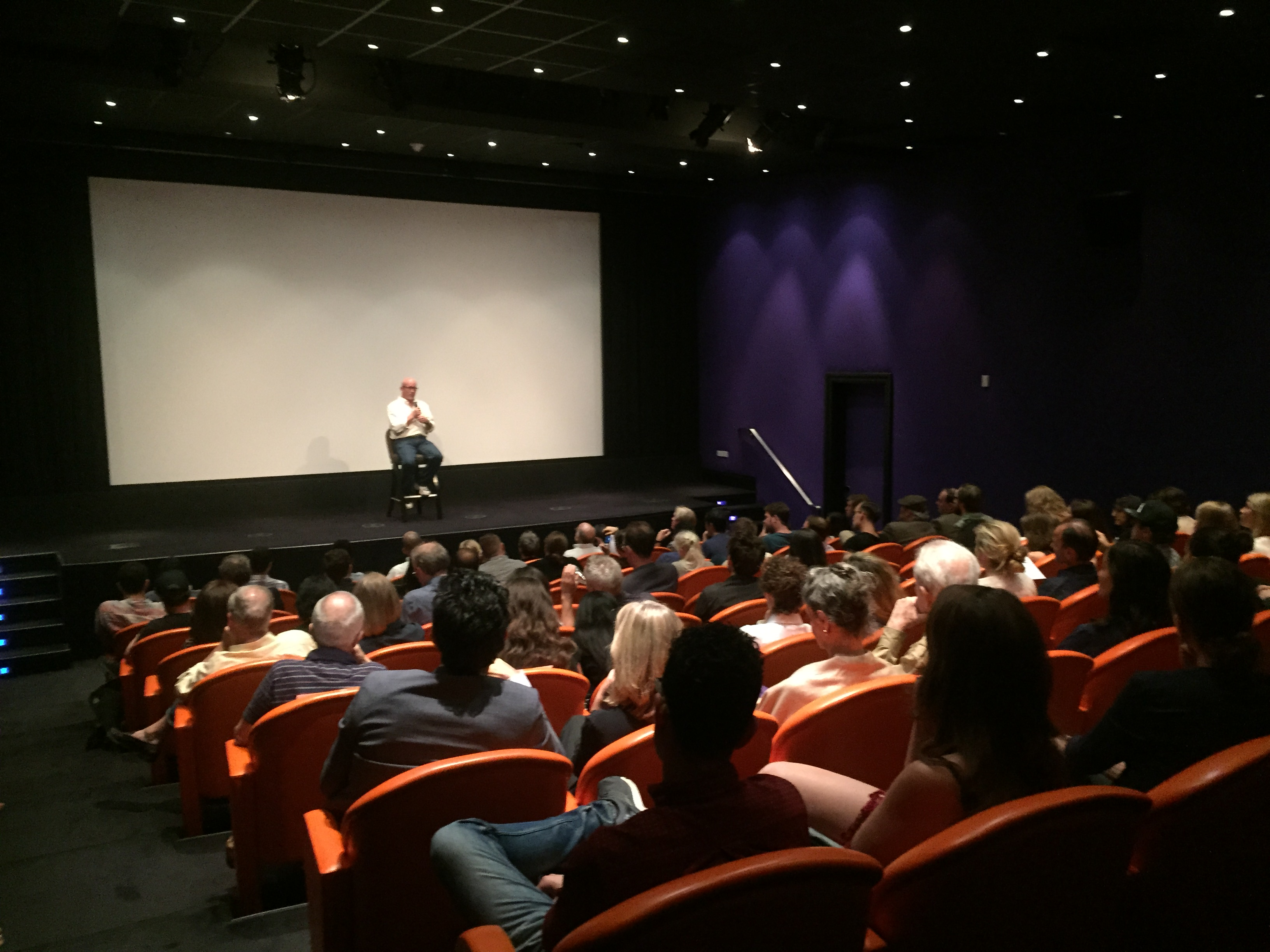 Director Alex Gibney answering questions on stage. (Photo: ASTRK)