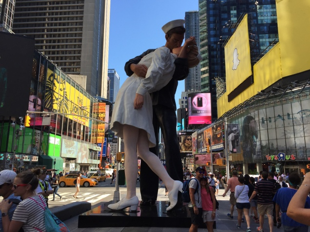 A 25-foot-tall sculpture by Seward Johnson of the world famous, lip-locked, sailor and nurse stands in Times Square for the upcoming Kiss-In event on August 14. (Photo: Alanna Martinez)