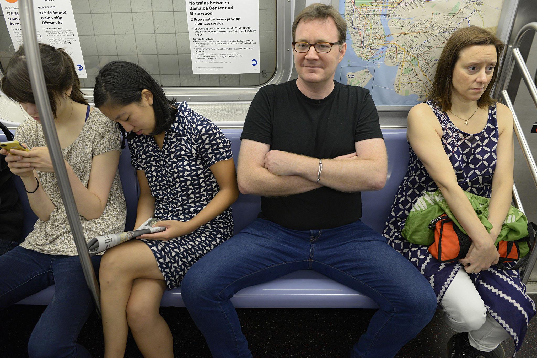 Manspreading on a subway car. (Photo: Richard Yeh / WNYC)