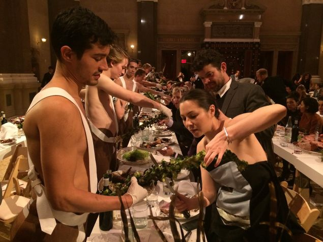 A guest at Performa's 2014 Gala carefully cuts brussell sprouts. (Photo: Performa)