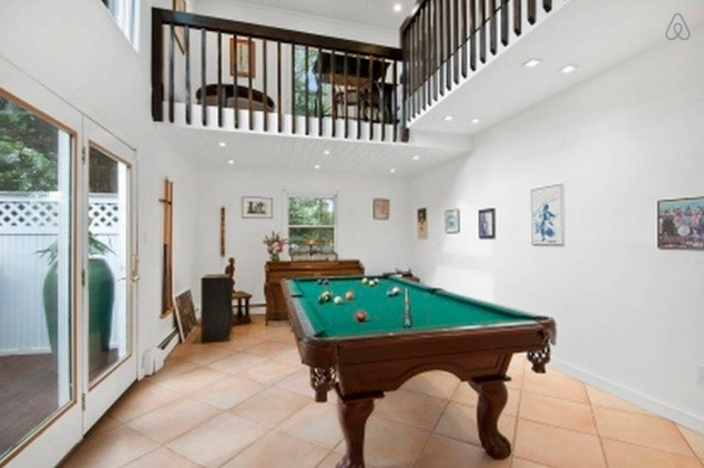 A pool table is always a welcome addition. Photo: Airbnb)