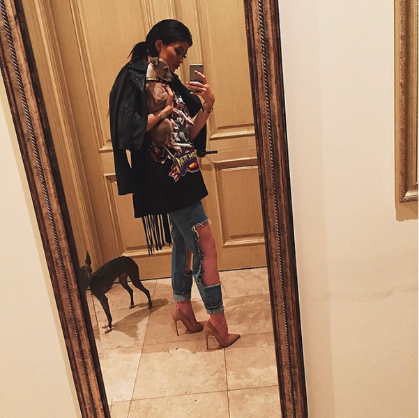Ms. Jenner posing with her dogs, Norm and Bambi. (Photo: Instagram/Kylie Jenner)