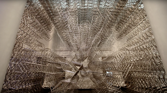 """Ai Weiwei's site-specific work Stacked (2014) for his Brooklyn Museum exhibition """"Ai Weiwei: According to What?"""" contained 700 bicycles. (Photo: still from Ai Weiwei: According to What?, Brooklyn Museum)"""