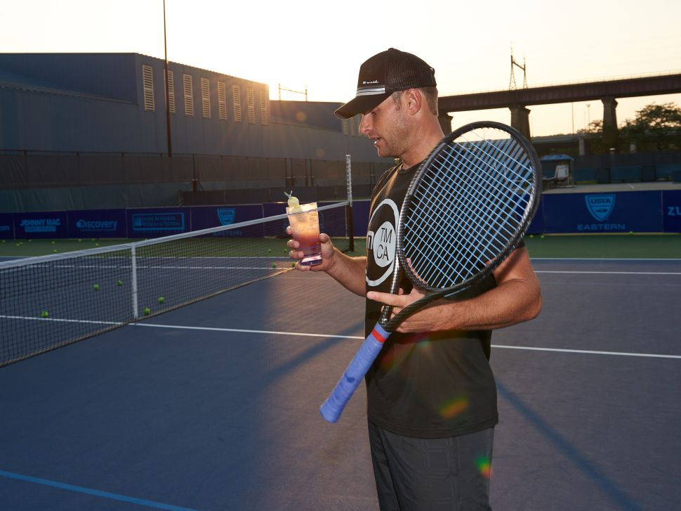 Andy Roddick enjoys an on-court cocktail (Photo: Grey Goose).