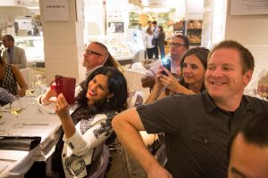 Guests snap a celeb chef at Eataly's Fifth Birthday Bash. Photograph by Michael Nagle for Observer.
