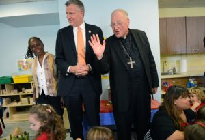 NEW YORK, NY - SEPTEMBER 4: New York Mayor Bill de Blasio and First Lady Chirlane McCray visit a Pre-K class on September 4, 2014 at Sacred Heart School in the Staten Island borough of New York City. New York Mayor Bill de Blasio is touring universal pre-kindergarten programs throughout the city. Also pictured (L-R) is First Lady Chirlane McCray, New York Mayor Bill de Blasio and Timothy Cardinal Dolan. (Photo by Susan Watts-Pool/Getty Images)