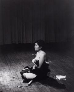 Cut Piece (1964) performed by Yoko Ono in New Works of Yoko Ono, Carnegie Recital Hall, New York, March 21, 1965. (Photo: by Minoru Niizuma, Courtesy of Lenono Photo Archive, New York)
