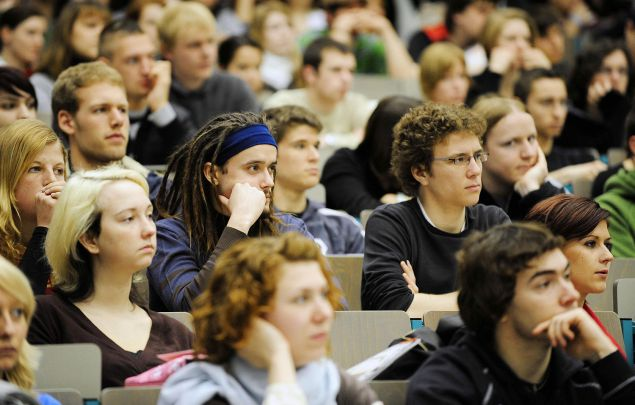 New students sit and listen as they are welcomed in one of the lecture halls. (Photo: TORSTEN SILZ/AFP/Getty Images)