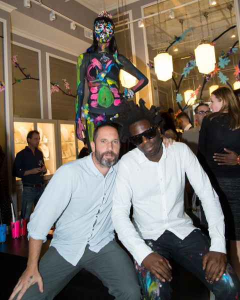 Alexis Bittar and Bradley Theodore post in front of Mr. Theodore's (literally) live artistic creation. (Photo: Ghila Krajzman)