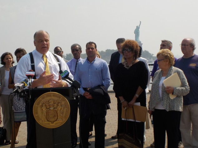 Sweeney stands with other state senators in Liberty State Park.