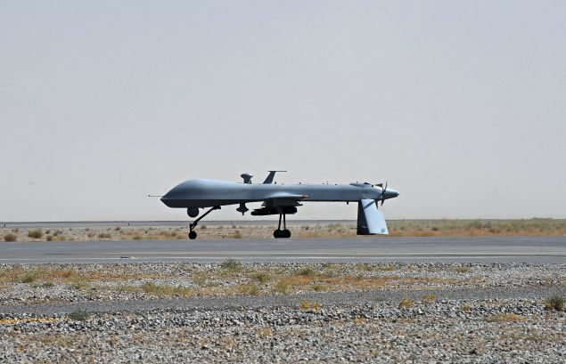 TO GO WITH: Pakistan-unrest-Afghanistan,FOCUS by Emmanuel Duparcq and S.H. Khan (FILES) In this file picture taken on on June 13, 2010, a US Predator unmanned drone armed with a missile stands on the tarmac of Kandahar military airport. Times are hard for Al-Qaeda in Afghanistan and Pakistan as the network has been weakened significantly by US drone strikes on their hideouts, the killing of founder Osama bin Laden in May 2011 and by finances drying up. AFP PHOTO/FILES/POOL/Massoud HOSSAINI (Photo credit should read MASSOUD HOSSAINI/AFP/Getty Images)