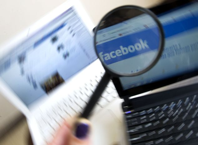 Picture of a magnifying glass on the homepage of Facebook website in Spanish language, taken in Medellin, Antioquia department, Colombia on May 12, 2012. AFP PHOTO/Raul ARBOLEDA (Photo credit should read RAUL ARBOLEDA/AFP/Getty Images)