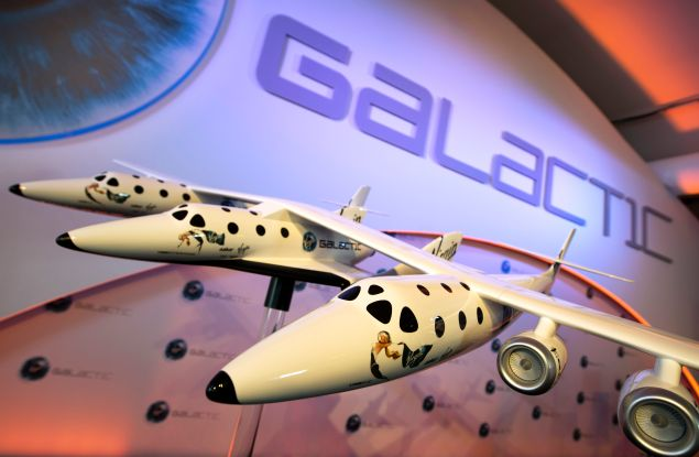 A model of the Virgin Galactic, the world?s first commercial spaceline, is displayed at the Farnborough International Airshow in Hampshire, southern England, on July 11, 2012. Virgin Galactic announced ?LauncherOne,? a new air-launched rocket specifically designed to deliver small satellites into orbit. Commercial flights of the new orbital launch vehicle are expected to begin by 2016, Virgin Galactic aims to offer frequent and dedicated launches at the world?s lowest prices. AFP PHOTO / ADRIAN DENNIS (Photo credit should read ADRIAN DENNIS/AFP/GettyImages)