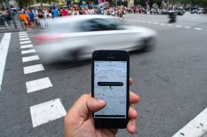 Man calls speeding Uber (Photo: David Ramos/Getty Images)