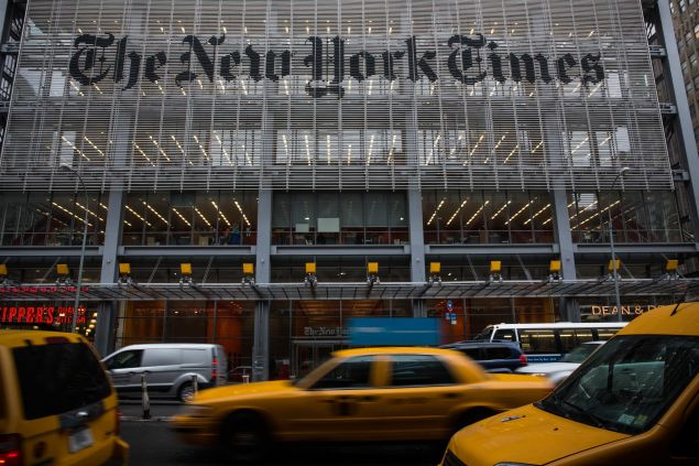 NEW YORK, NY - OCTOBER 01: Traffic drives past The New York Times building on October 1, 2014 in New York City. The Times announced plans to cut approximately 100 jobs from the newsroom today, with the company announcing it will start with buy-out packages before moving to layoffs. (Photo by Andrew Burton/Getty Images)