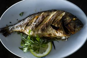 A picture shows a Sea Bream grilled with oil and lemon on the table at a restaurant in Cairo on October 23, 2014. AFP PHOTO/ KHALED DESOUKI (Photo credit should read KHALED DESOUKI/AFP/Getty Images)