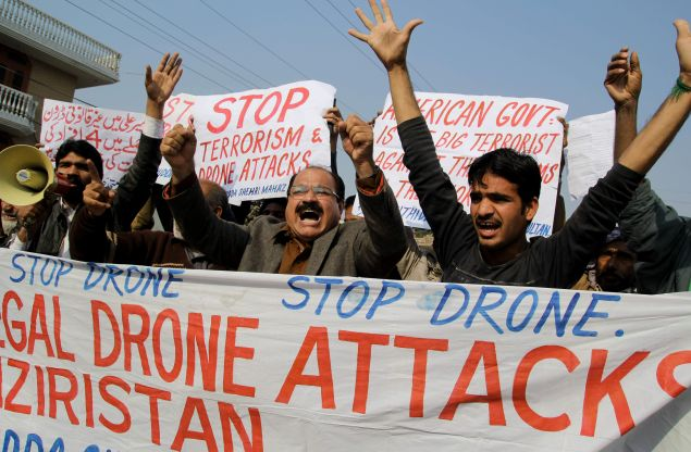 Activists from the Muttahida Shehri Mahaz shout slogans as they protest against a US drone attack in Multan on December 26, 2103. A US drone strike targeting a militant compound killed at least three suspected insurgents in a restive Pakistani tribal region near the Afghan border late December 25, officials said. AFP PHOTO/S S MIRZA (Photo credit should read S S MIRZA/AFP/Getty Images)