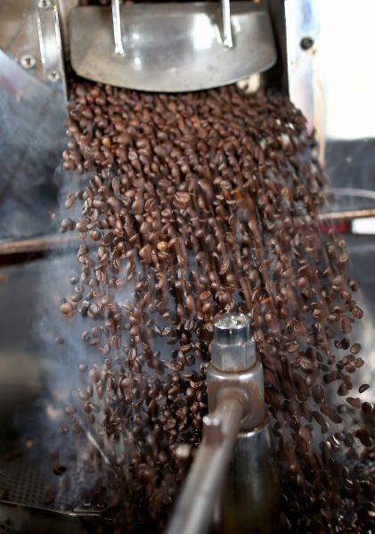 MARGATE, FL - MARCH 10:  Coffee beans are seen in the roaster during the process of making the Miami Beach blend of coffee at the Kana Coffee Roasters on March 10, 2015 in Margate, Florida. A panel of government-appointed scientists at the Dietary Guidelines Advisory Committee charged with proposing changes to U.S. dietary guidelines announced recently that three to five cups of coffee daily do not have long-term health risks, and help reduce the risk for heart disease and type 2 diabetes.  (Photo by Joe Raedle/Getty Images)