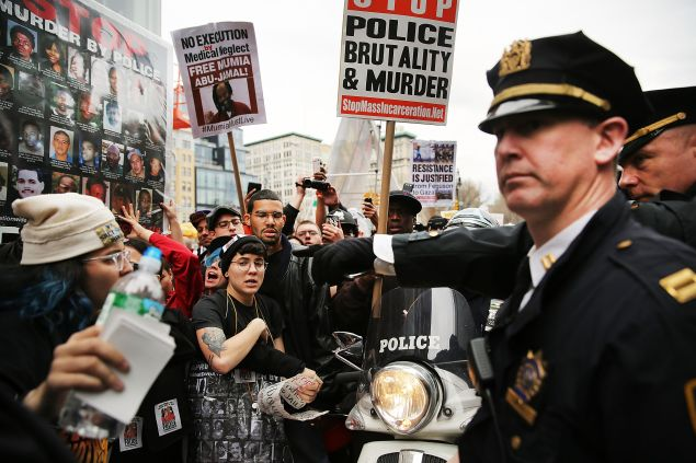 Protesters scuffle with police during a march against police violence in Manhattan on April 14, 2015 (Photo by Spencer Platt/Getty Images)