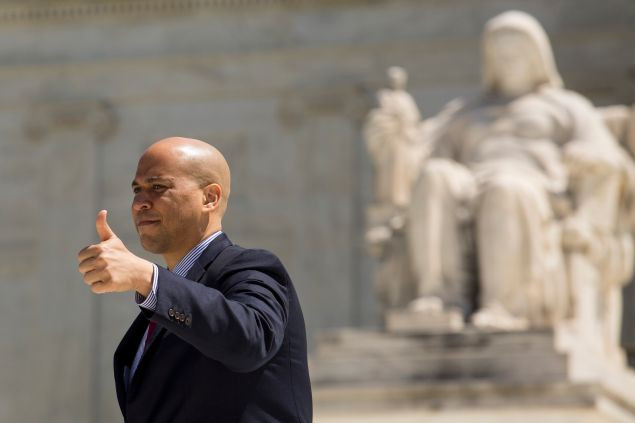 WASHINGTON, DC - APRIL 28: Sen. Cory Booker (D-NJ), gives the thumbs up to the crowd as he exits the Supreme Court after oral arguments were completed in the Obergefell v. Hodges case, April 28, 2015 in Washington, DC. On Tuesday the Supreme Court heard arguments concerning whether same-sex marriage is a constitutional right, with decisions expected in June. (Photo by Drew Angerer/Getty Images)