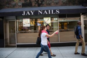 A nail salon in the Greenwich Village neighborhood of New York City. (Photo by Andrew Burton/Getty Images)