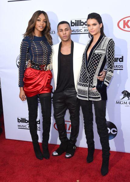 Olivier Rousteing with Jourdan Dunn and Kendall Jenner, all in Balmain x H&M (Photo: Jason Merritt/Getty Images).