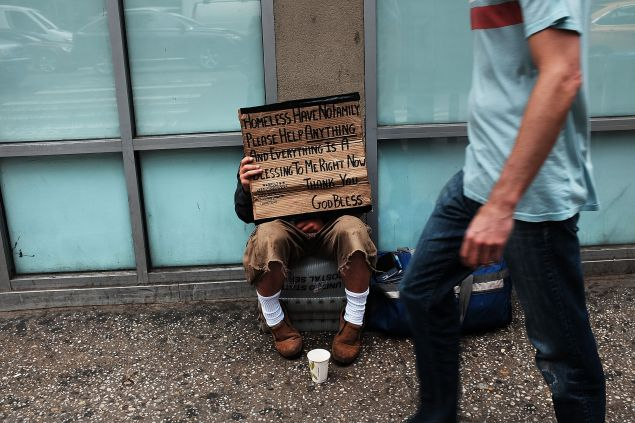 NEW YORK, NY - MAY 18: A homeless man panhandles along Eighth Avenue in Manhattan on May 18, 2015 in New York City. As many parts of once seedy New York City have been transformed into family and shopping friendly environments, 8th Avenue near the Port Authority bus station is one of the last hold-outs to old gritty Manhattan. Last week a man was shot by police after he attacked numerous people with a hammer along a stretch of the street. There is a high police presence along the street and fights and arrests for vagrancy are common. (Photo by Spencer Platt/Getty Images)