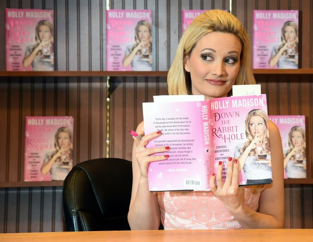 "LAS VEGAS, NV - JULY 01: Model and television personality Holly Madison attends a signing for her new book ""Down the Rabbit Hole: Curious Adventures and Cautionary Tales of a Former Playboy Bunny"" at a Barnes & Noble Booksellers on July 1, 2015 in Las Vegas, Nevada. (Photo by Ethan Miller/Getty Images)"