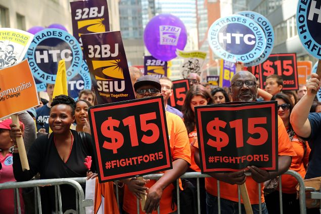 NEW YORK, NY - JULY 22: Labor leaders, workers and activists attend a rally for a $15 minimum hourly wage on July 22, 2015 in New York City. A panel appointed by Governor Andrew Cuomo recommended on Wednesday that the minimum wage be raised for employees of fast-food chain restaurants throughout the state. The panel recommended that the $15 rate be phased in by December 31, 2018 for New York City and by July 1, 2021 for the rest of the state. (Photo by Spencer Platt/Getty Images)
