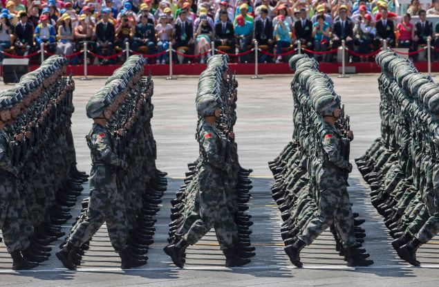 BEIJING, CHINA - SEPTEMBER 03: Chinese soldiers march in formation passed Tiananmen Square and the Forbidden City during a military parade on September 3, 2015 in Beijing, China. China is marking the 70th anniversary of the end of World War II and its role in defeating Japan with a new national holiday and a military parade in Beijing. (Photo by Kevin Frayer/Getty Images)