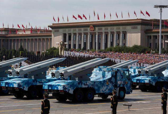 BEIJING, CHINA - SEPTEMBER 03: Chinese missiles are seen on trucks as they drive next to Tiananmen Square and the Great Hall of the People during a military parade on September 3, 2015 in Beijing, China. China is marking the 70th anniversary of the end of World War II and its role in defeating Japan with a new national holiday and a military parade in Beijing. (Photo by Kevin Frayer/Getty Images)