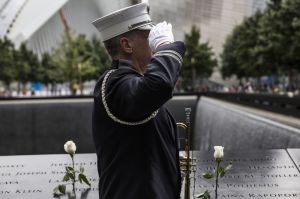 NEW YORK, NY - SEPTEMBER 11: Captain Tom Engel of the New York Fire Department plays taps at the end of the ceremony commemorating the 14th anniversary of the September 11th terrorist attacks on September 11, 2015 in New York City. Today marks the 14th anniversary of the attacks where nearly 3,000 people were killed in New York, Washington D.C. and Pennsylvania. (Photo by Andrew Burton/Getty Images)