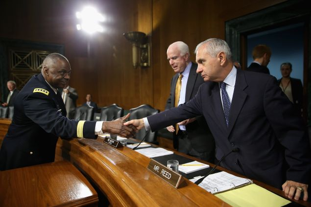 WASHINGTON, DC - SEPTEMBER 16: Gen. Lloyd Austin III (L), commander of U.S. Central Command, greets Senate Armed Services Committee ranking member Sen. Jack Reed (D-RI) (R) and Chairman John McCain (R-AZ) before a hearing about the ongoing U.S. military operations to counter the Islamic State in Iraq and the Levant (ISIL) during a hearing in the Dirksen Senate Office Building on Capitol Hill September 16, 2015 in Washington, DC. Austin said that slow progress was still being made against ISIL but there have been setbacks, including the ambush of U.S.-trained fighters in Syria and the buildup of Russian forces in the country. (Photo by Chip Somodevilla/Getty Images)