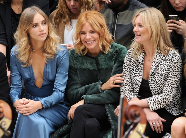 Suki Waterhouse, Sienna Miller and Kate Moss in their Burberry best (Photo: Stuart C. Wilson/Getty Images for Burberry).