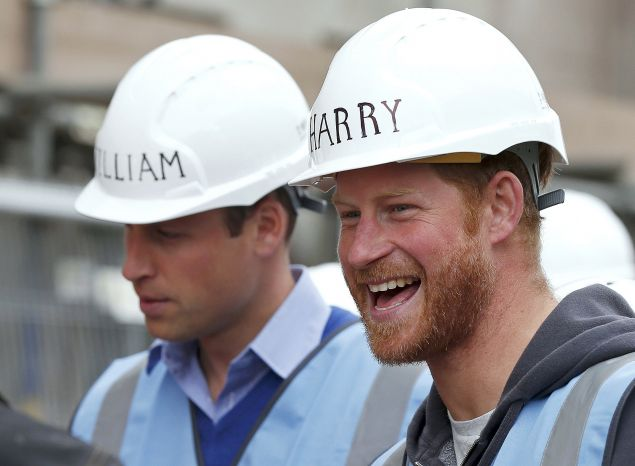 The princes could make hard hats a fashion trend. (Photo: PHIL NOBLE/AFP/Getty Images)